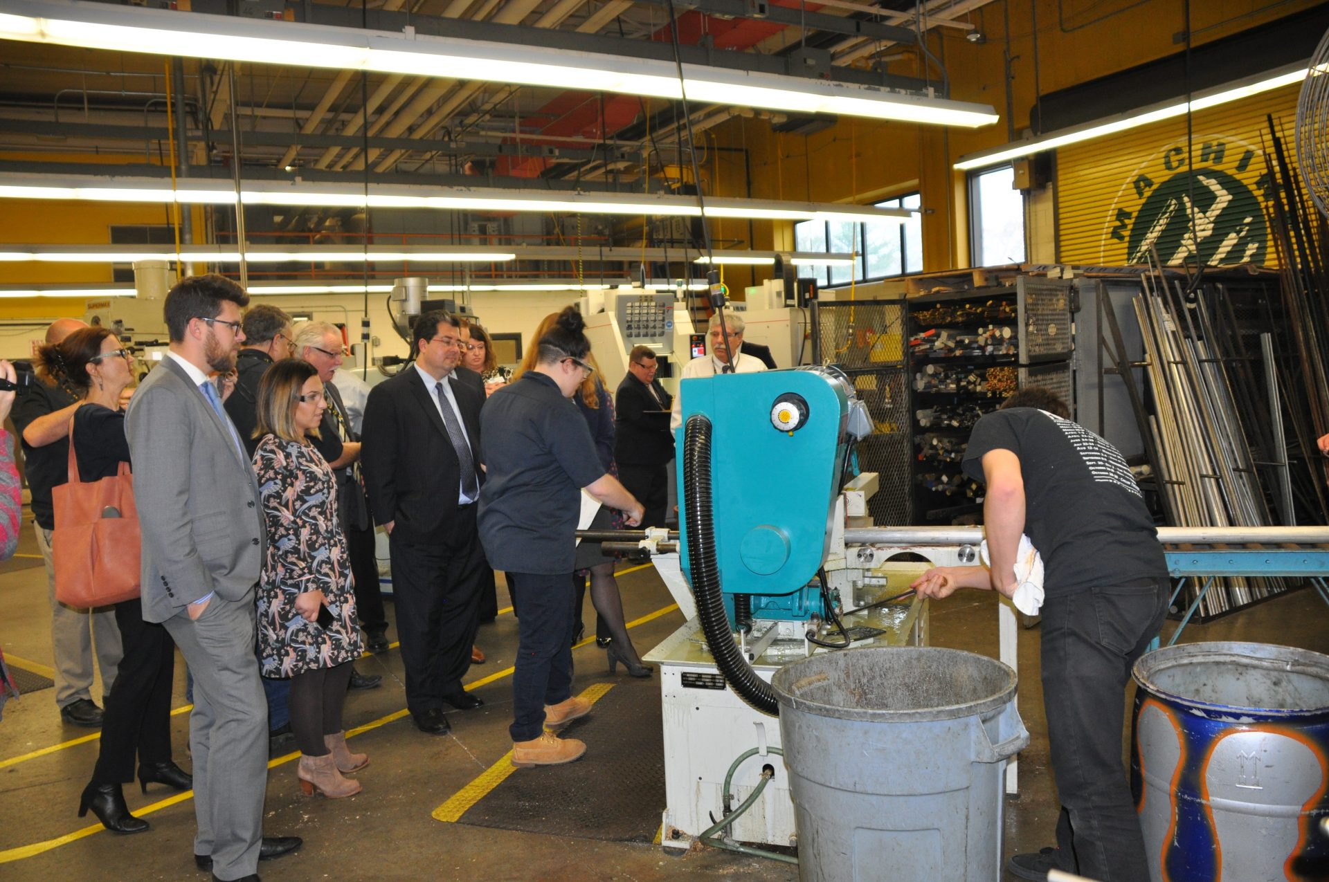 machine technology students showing adults how machine works