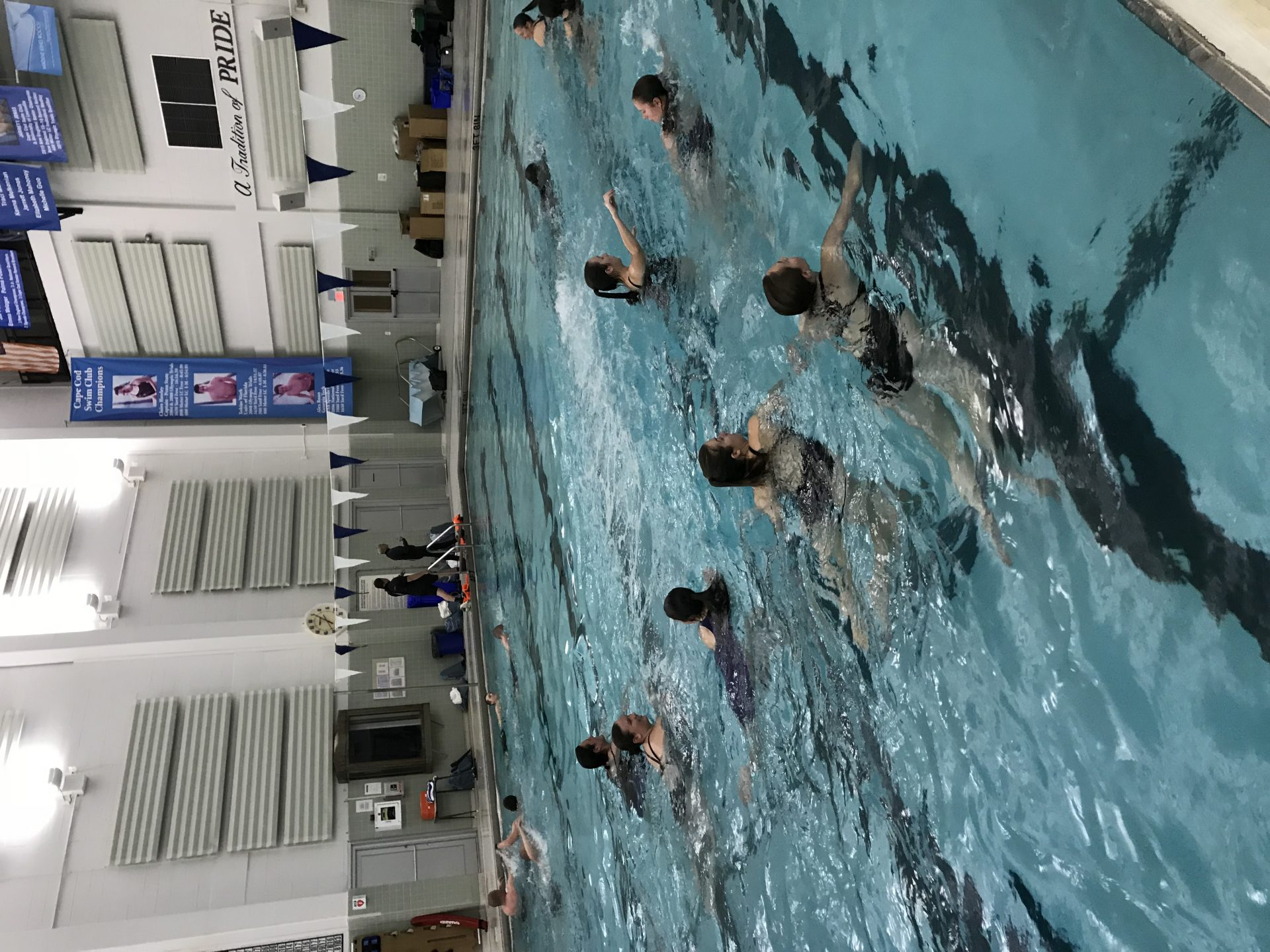 scuba divers swimming in pool