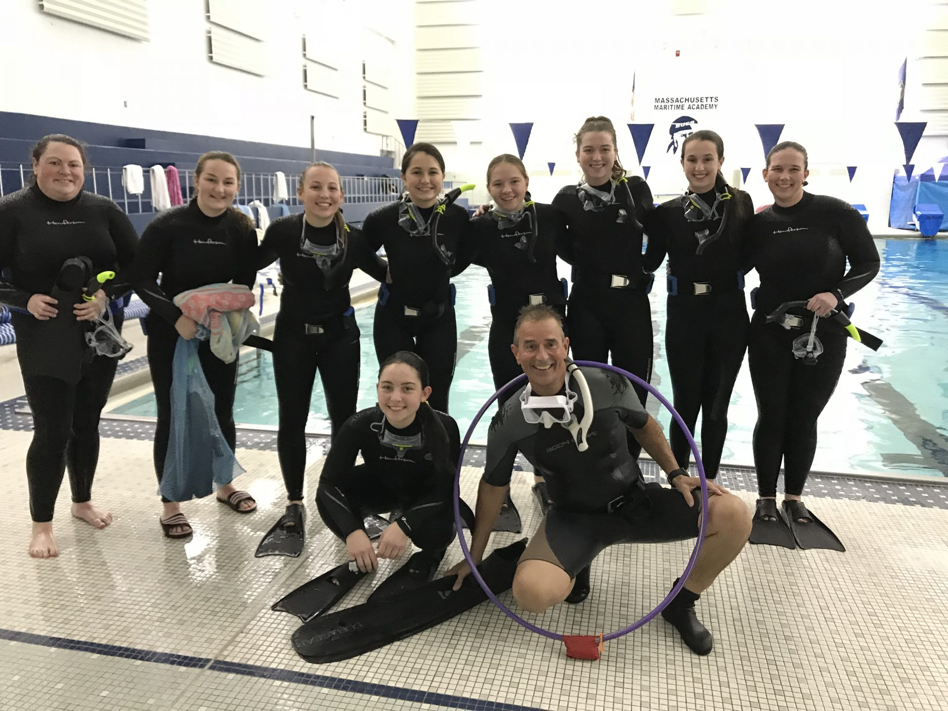 female scuba divers in group photos