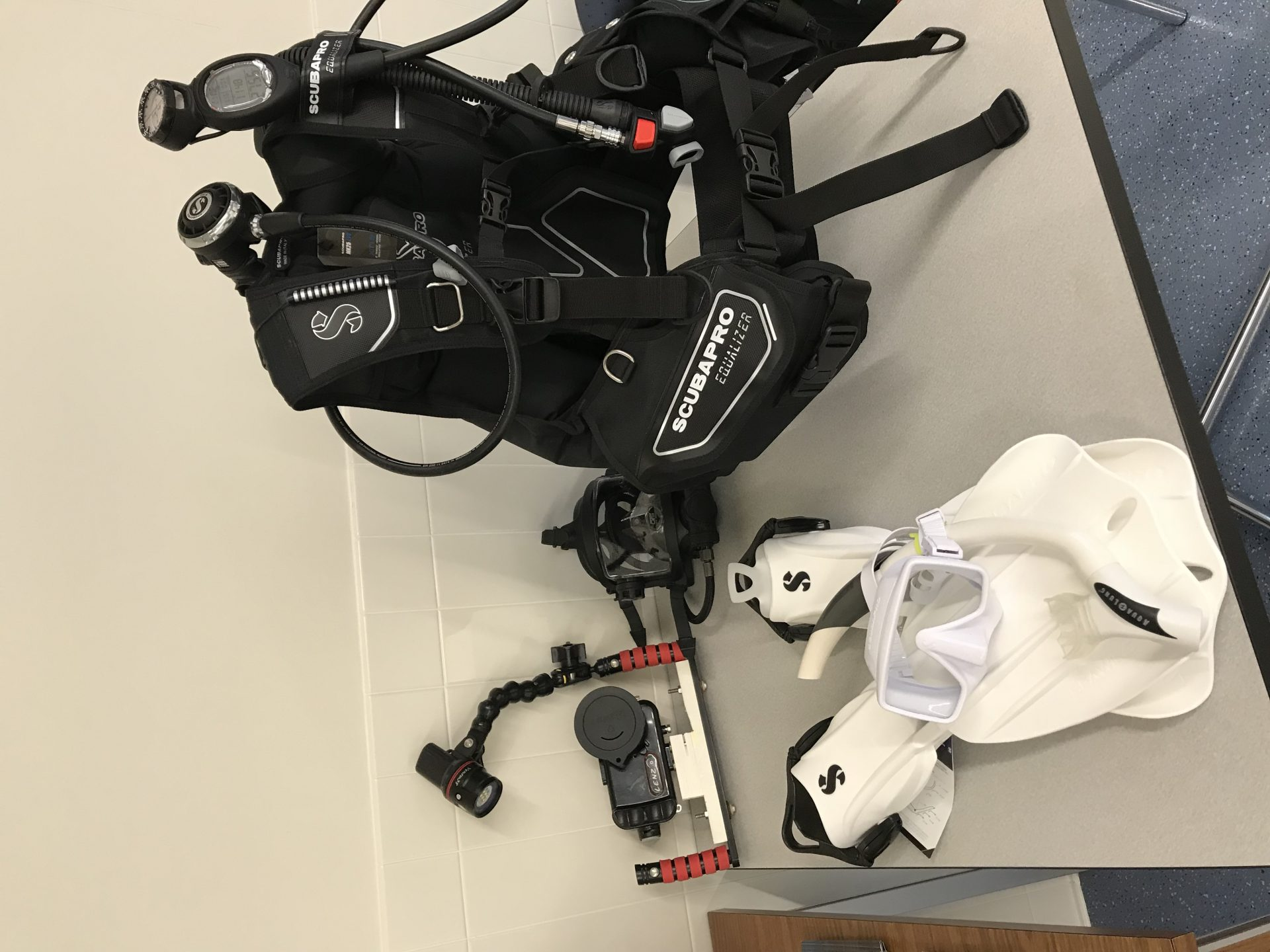 scuba vest with goggles and breathing equipment