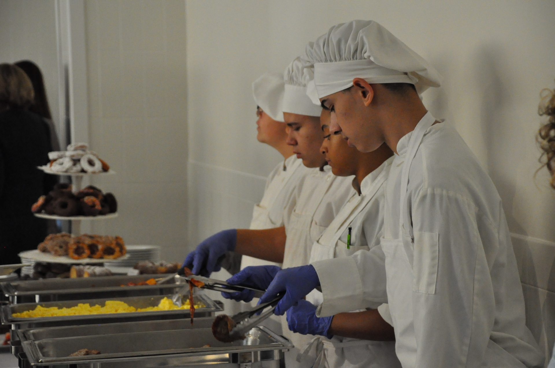 culinary group looking at the food