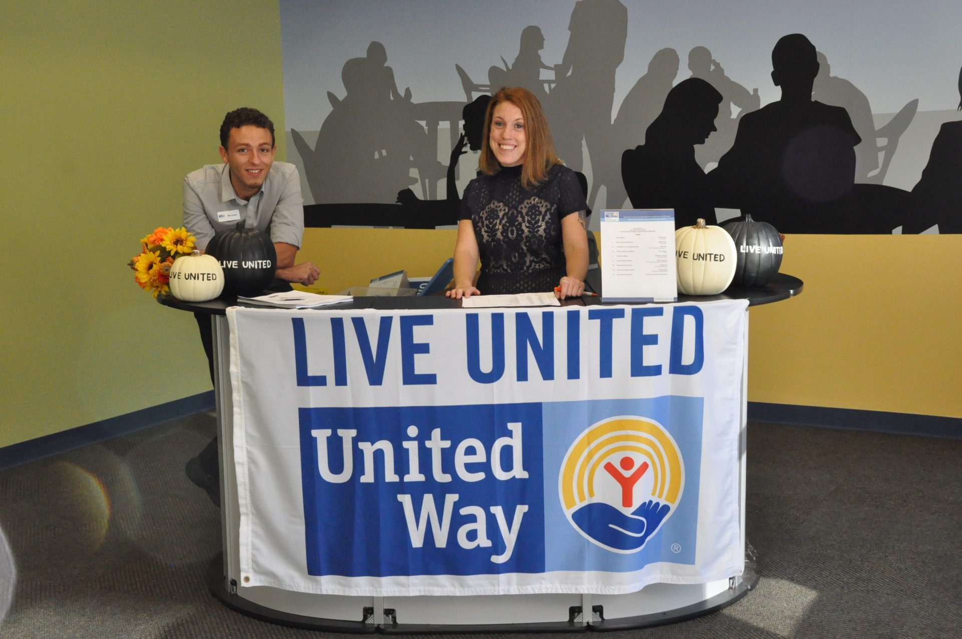 live united banner on table with two people sitting