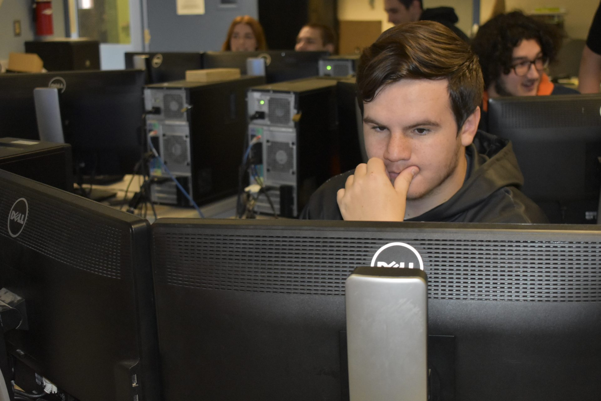 Programming student working on computer
