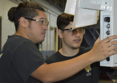 Machine Technology students working together