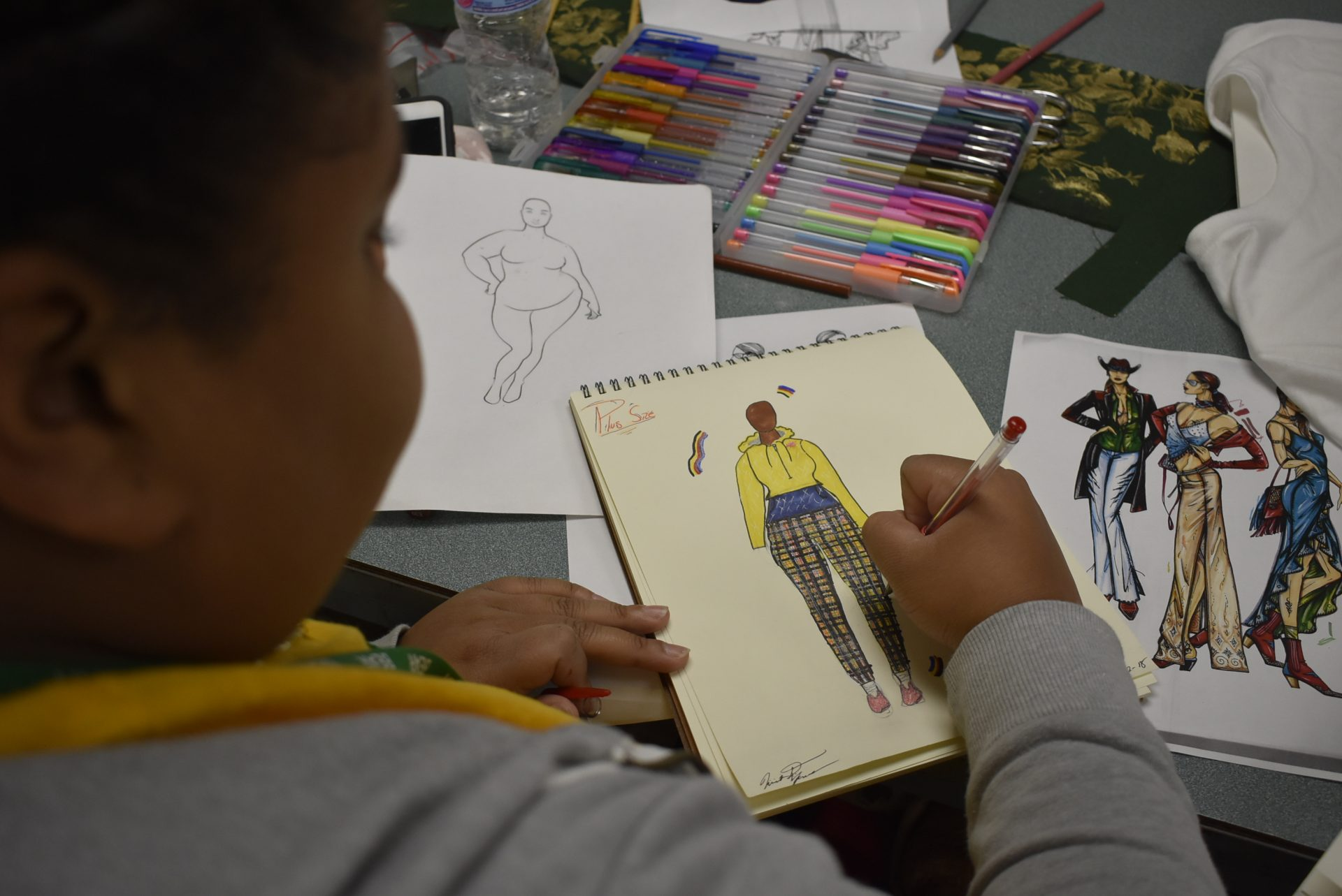 Fashion Design student drawing an outfit
