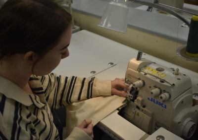 fashion design students sewing fabric