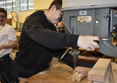 Carpentry Student working with a drill