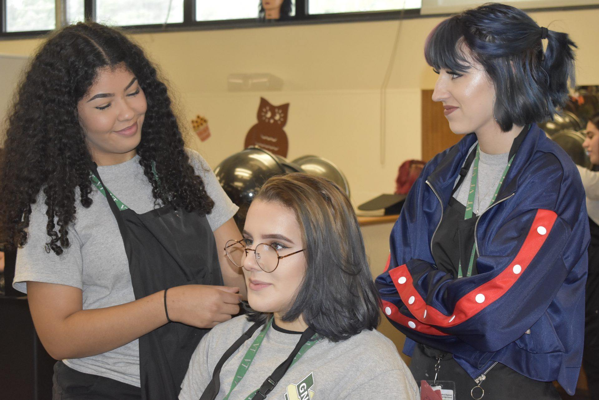 Cosmetology students working on someone's hair