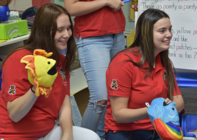 Childcare students with puppets