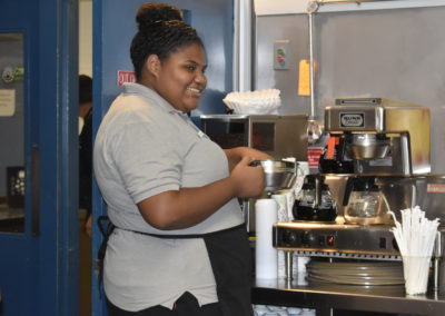 culinary student making coffee