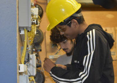 Electrical students working