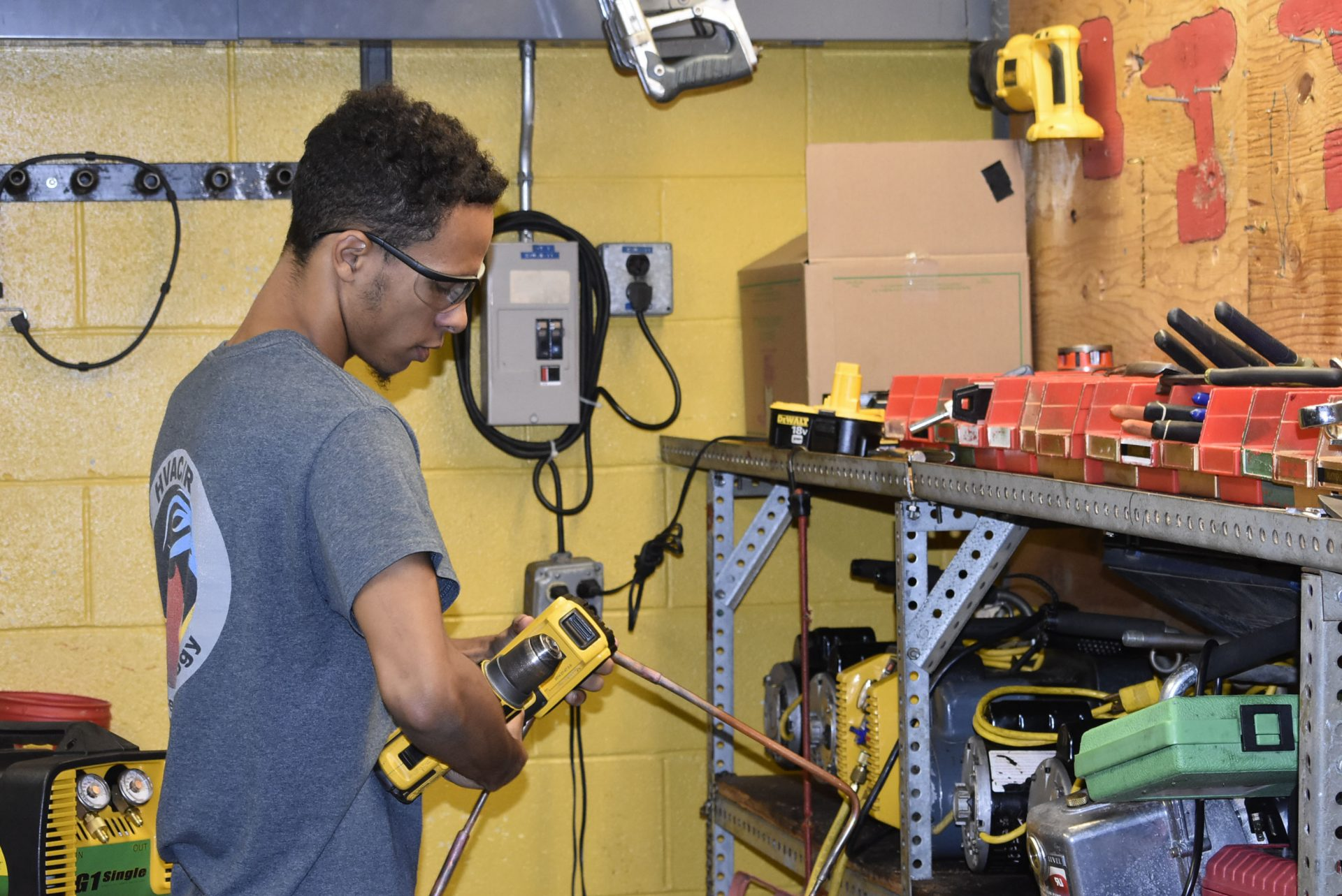 HVAC student with tools