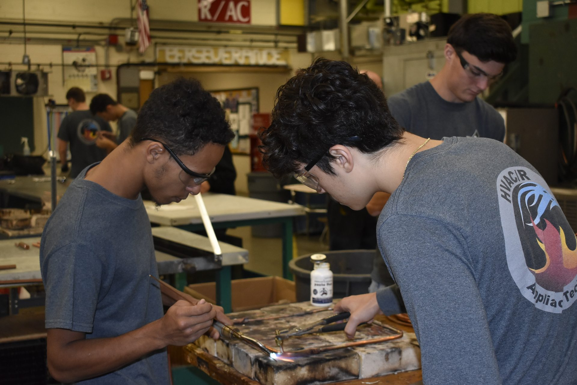 HVAC students using a blow torch