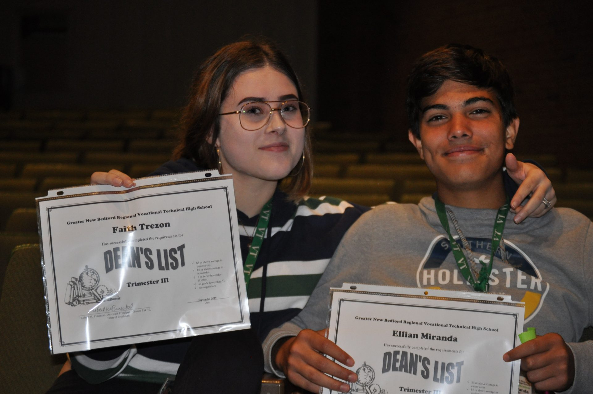 Two students holding their Dean's List awards