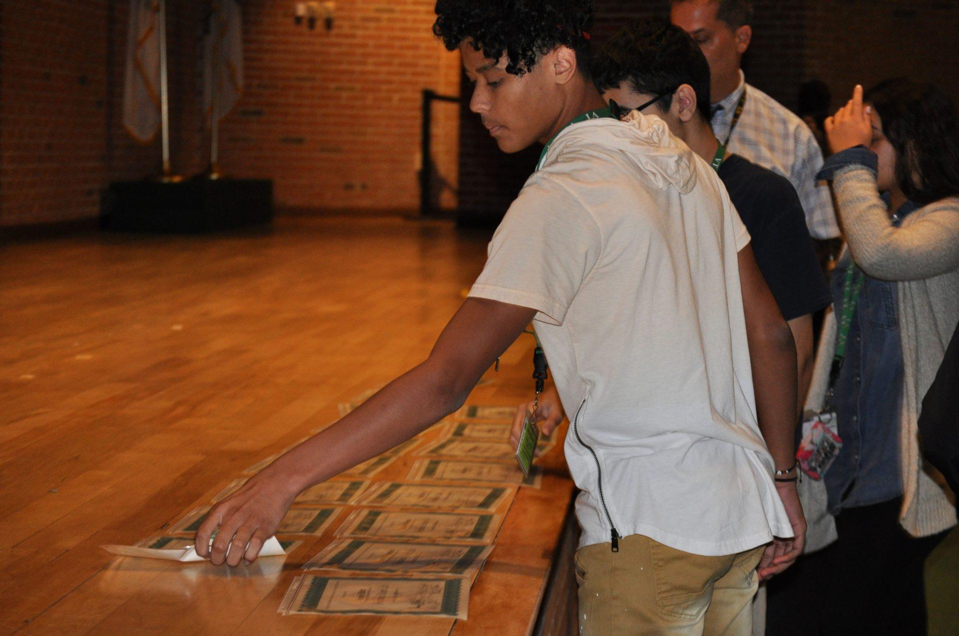 Student grabbing his award