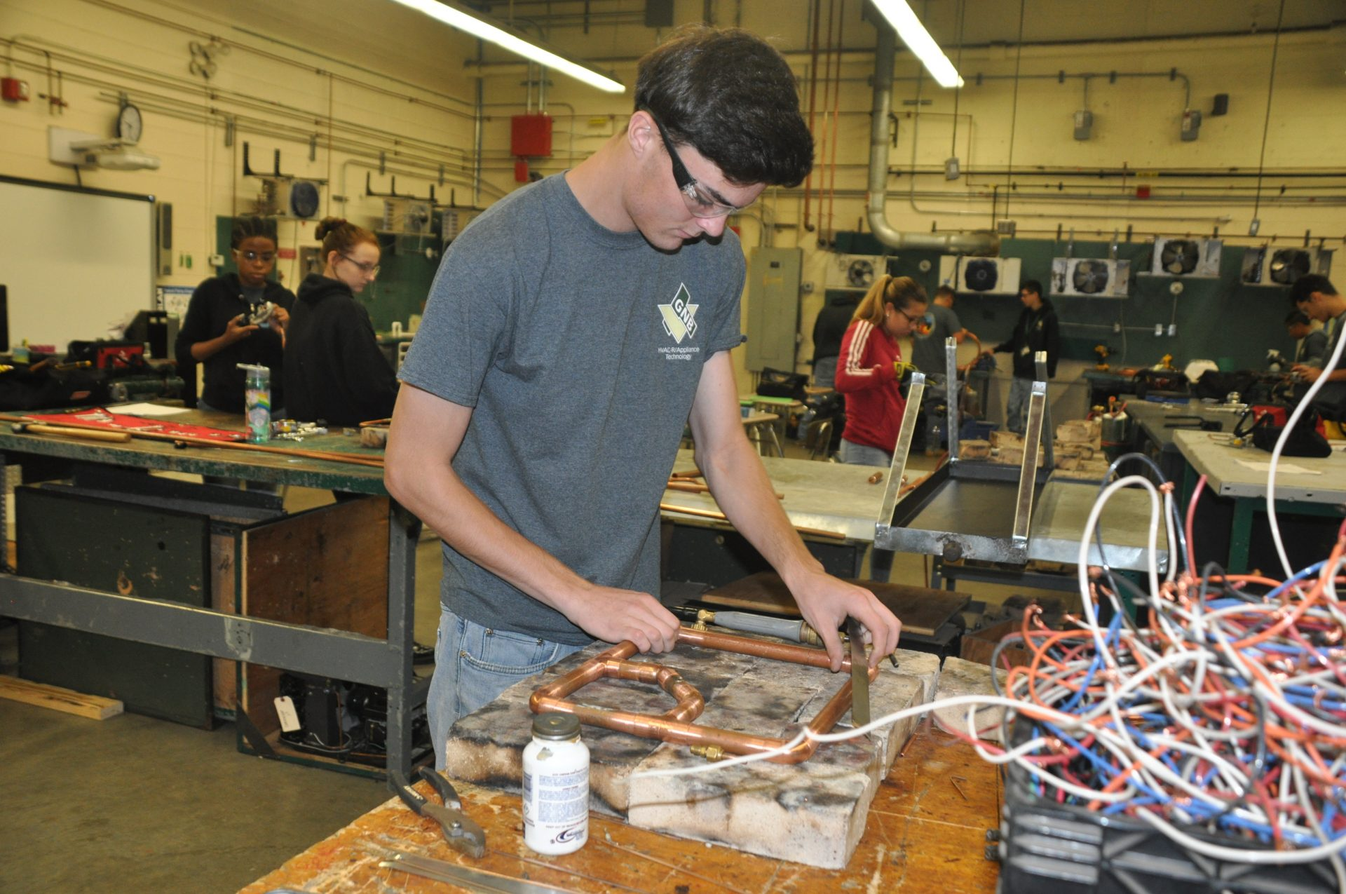 HVAC student working at table