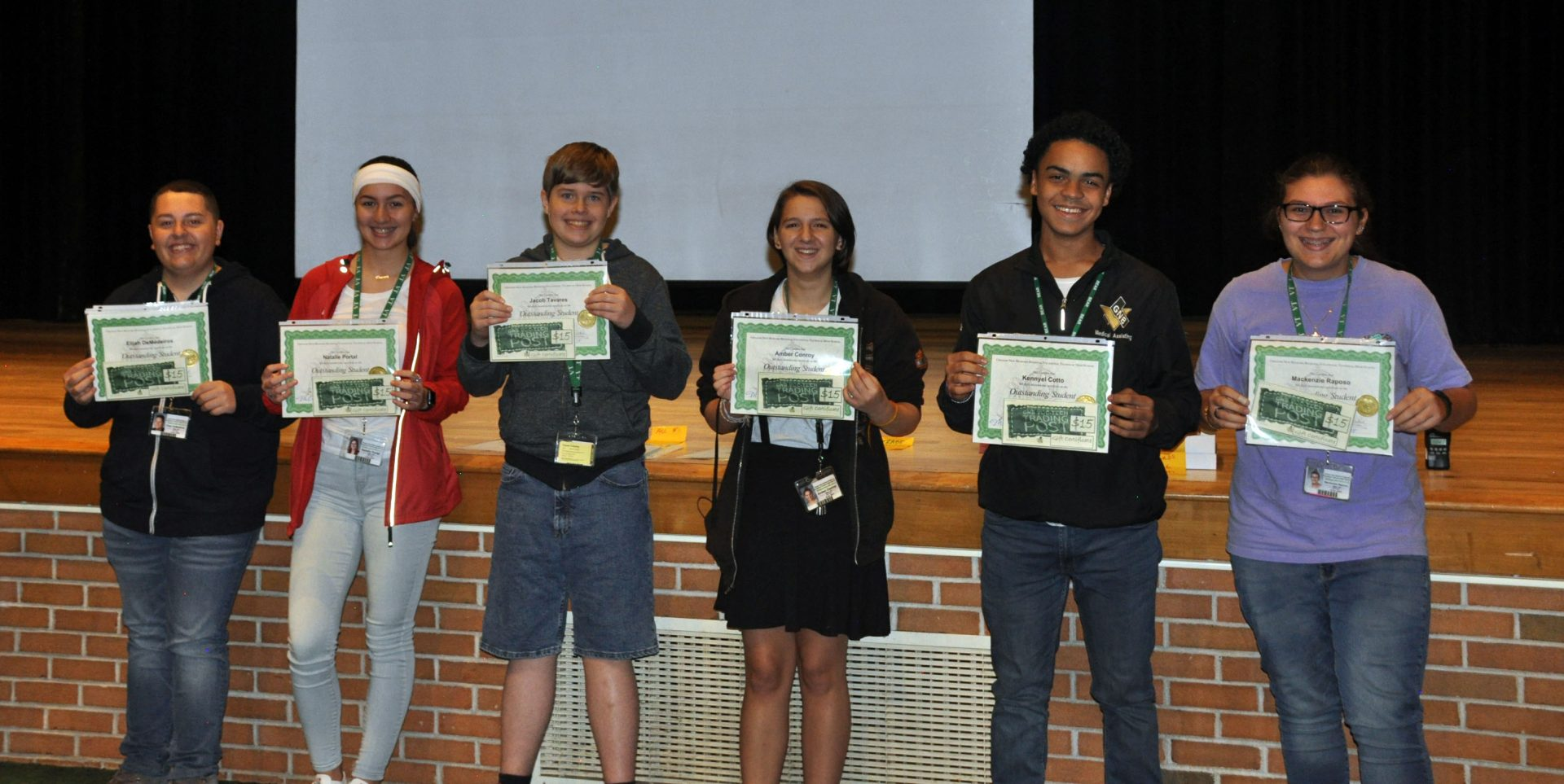 The 6 highest honor freshman students holding their awards