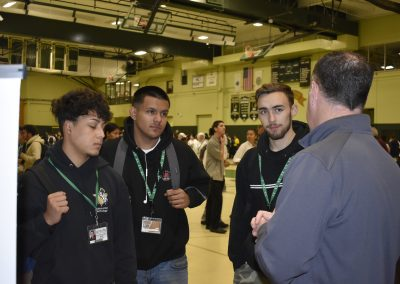 Automotive Students Talking To College Advisor