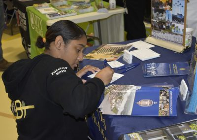 Student Signing United States Naval Academy Paper