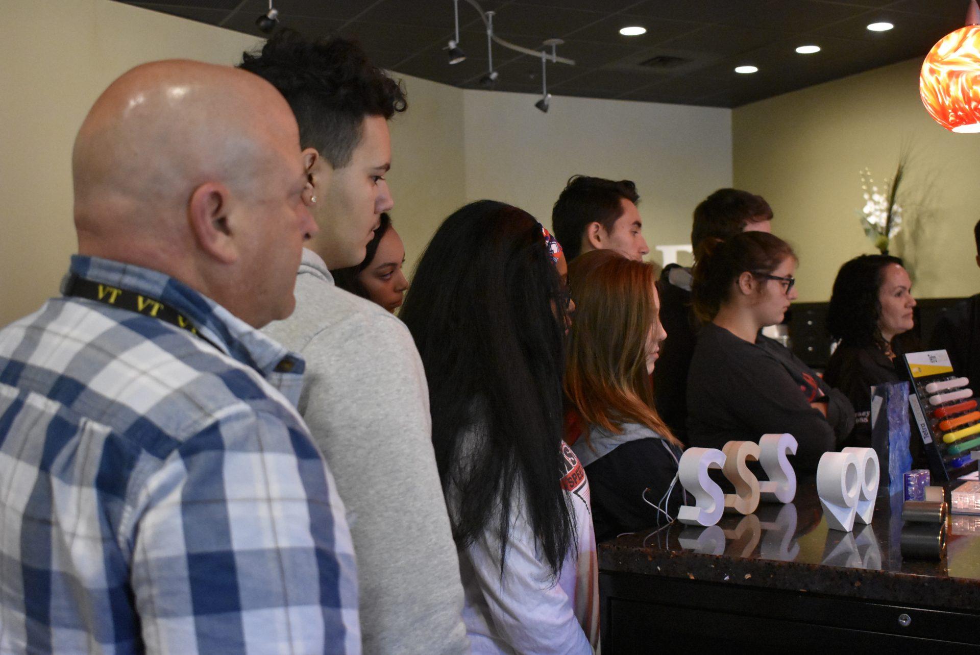 Architectural Design Students with Teacher Watching Presenter