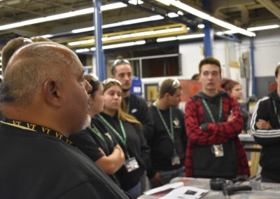 Welding Technology Students and Teacher Listening to Presenter