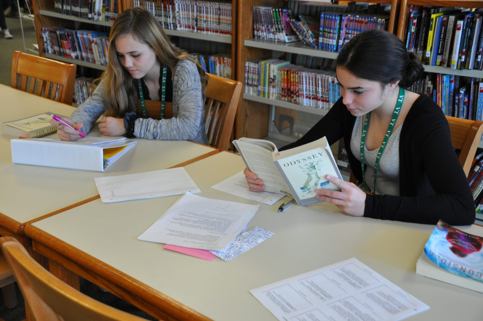 Students reading and writing in the library