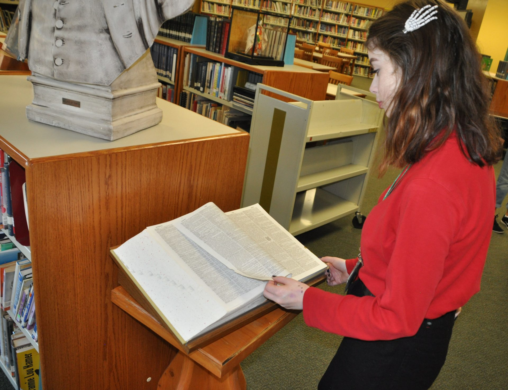 Student looking at a dictionary