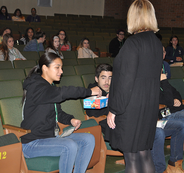 Student choosing a ticket out of a box