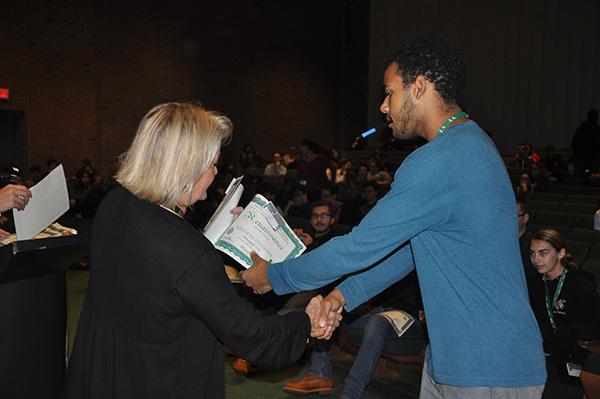 Student receiving renaissance award