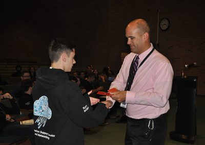 Student receiving award