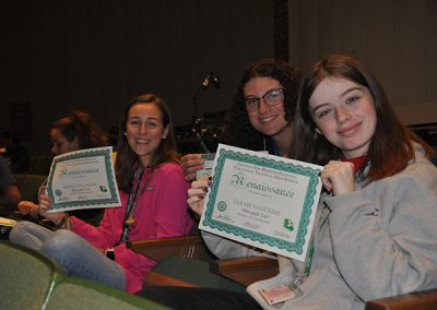 Students holding up renaissance awards