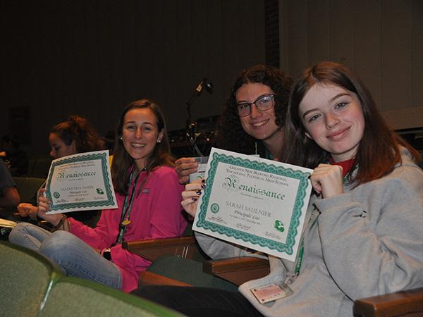 Students holding up renaissance awards
