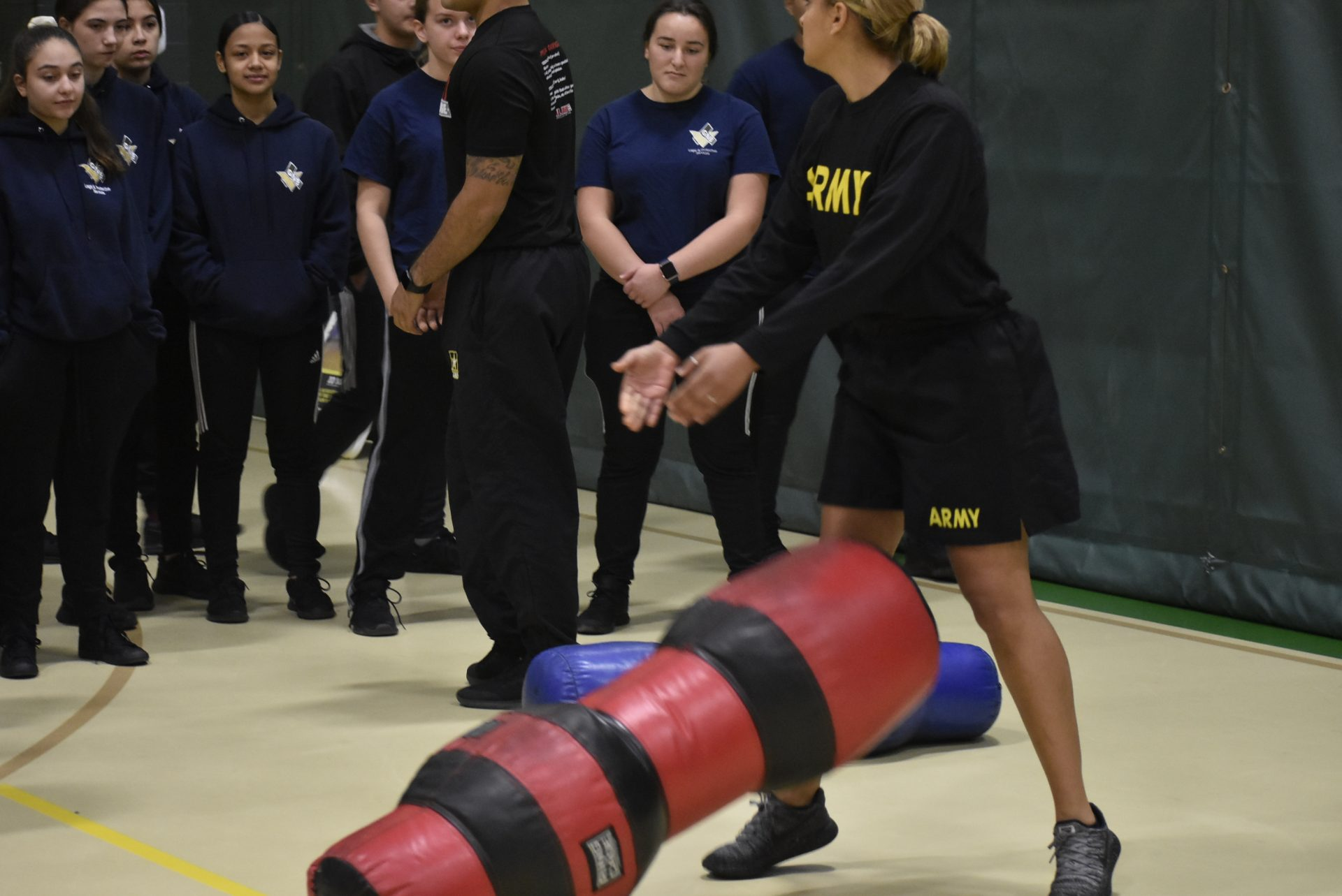 Army member rolling weights