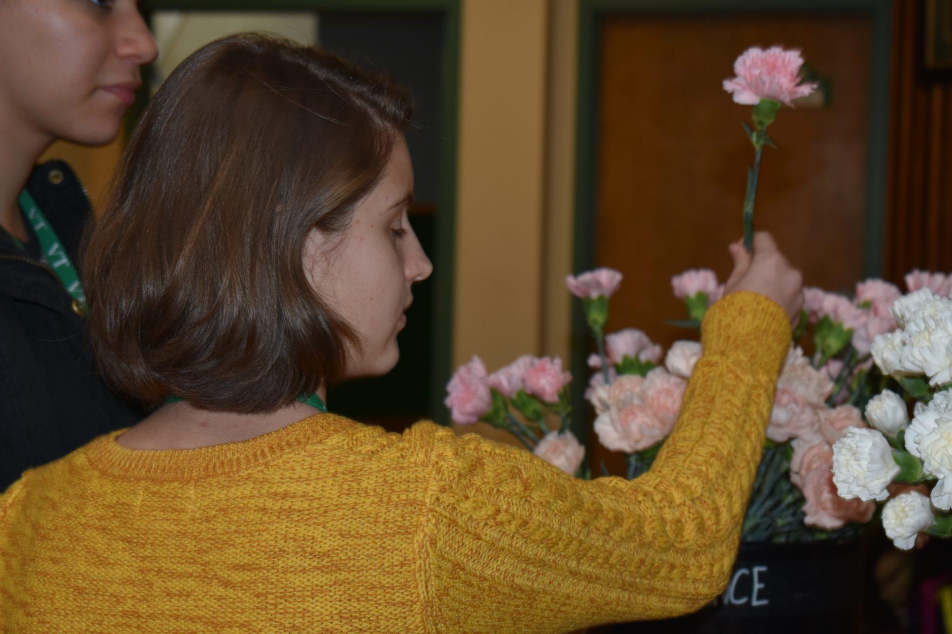 holding pink flower