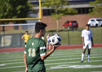 Number 13 holding soccer ball