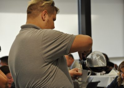 Culinary Student Pouring Coffee