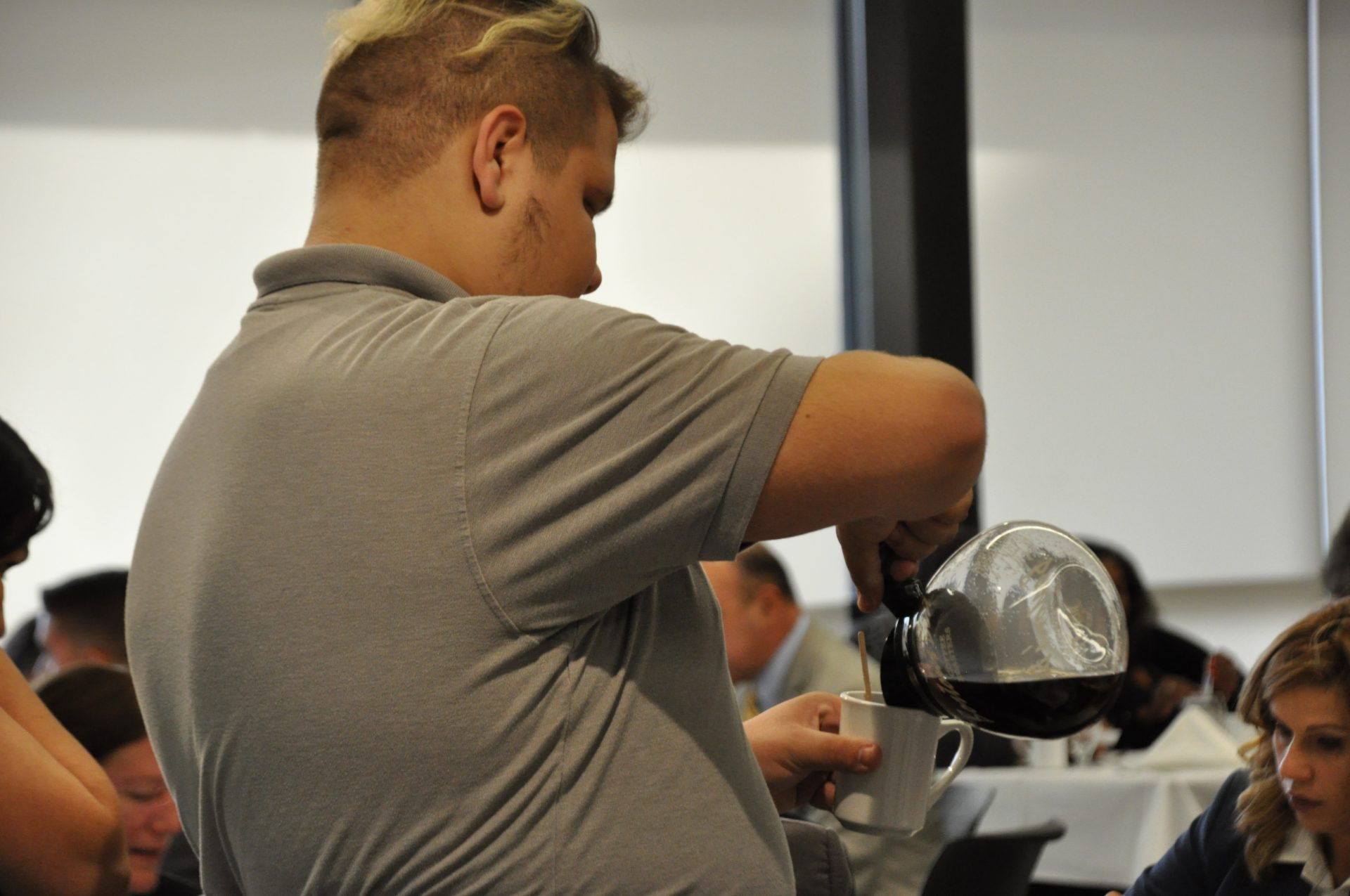 Culinary Student Pouring Coffee (side View)