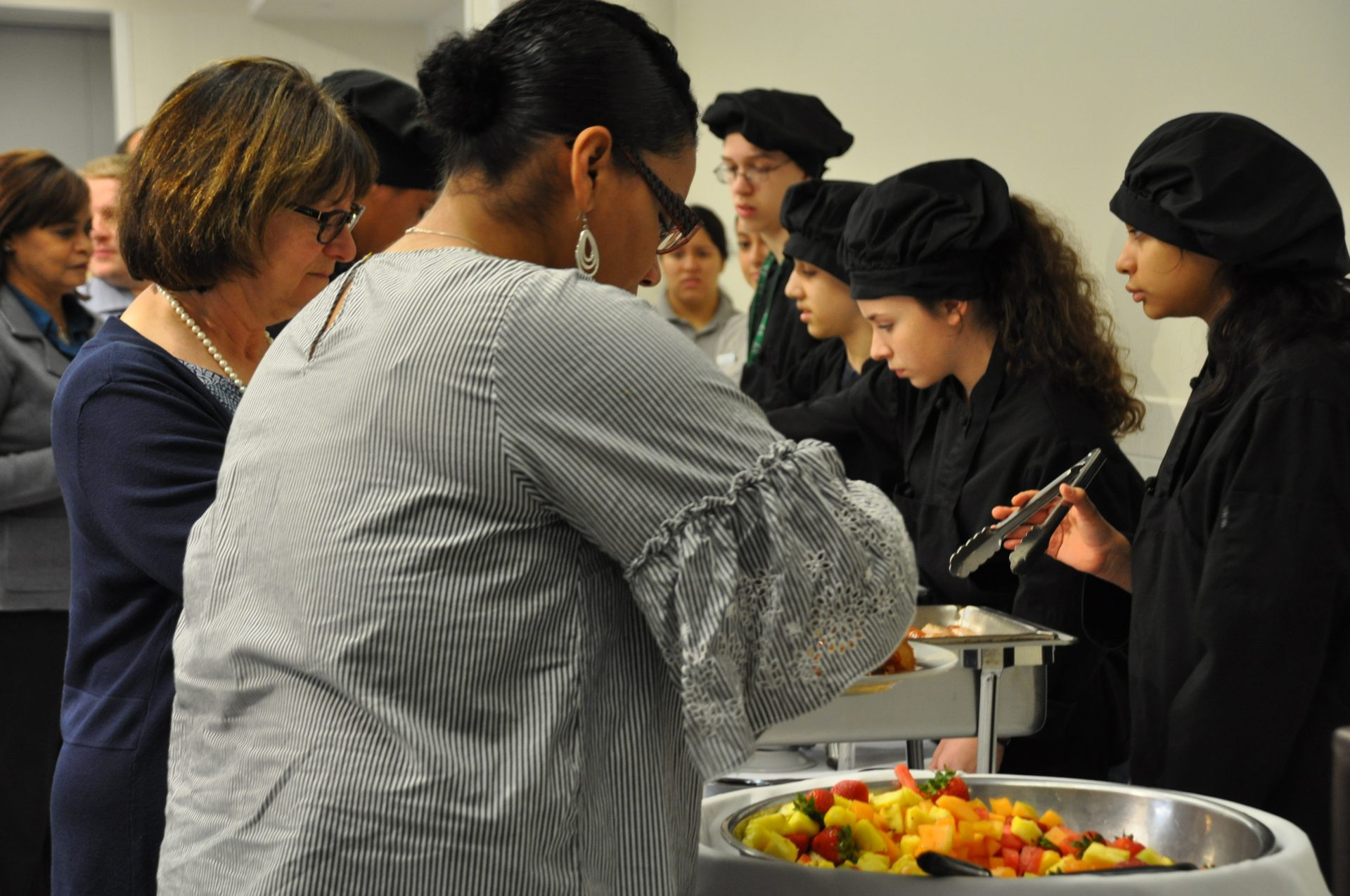 United Way Officials Being Served By Culinary Students