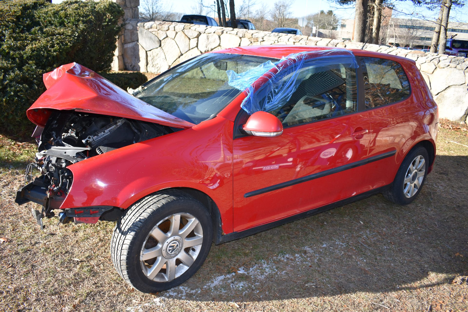 profile of totaled red Volkswagen