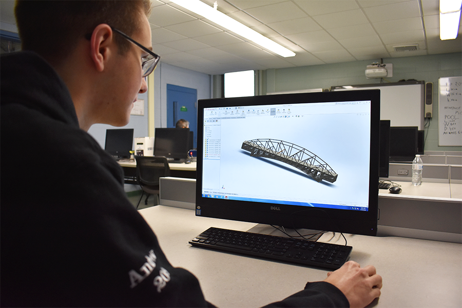 Engineering student, Andrew Sullivan, working on digital model of a bridge