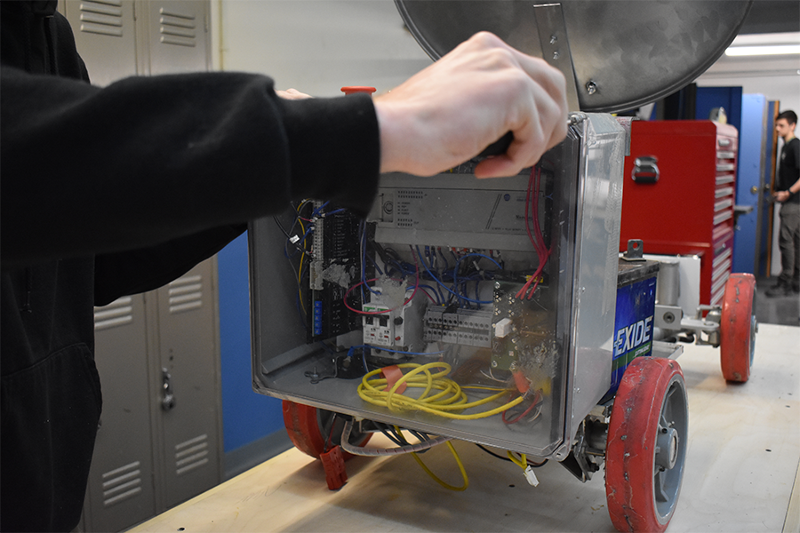 Engineering student, Andrew Sullivan, working on the back controls of a rover
