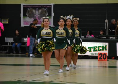 The cheerleaders perform during half time.