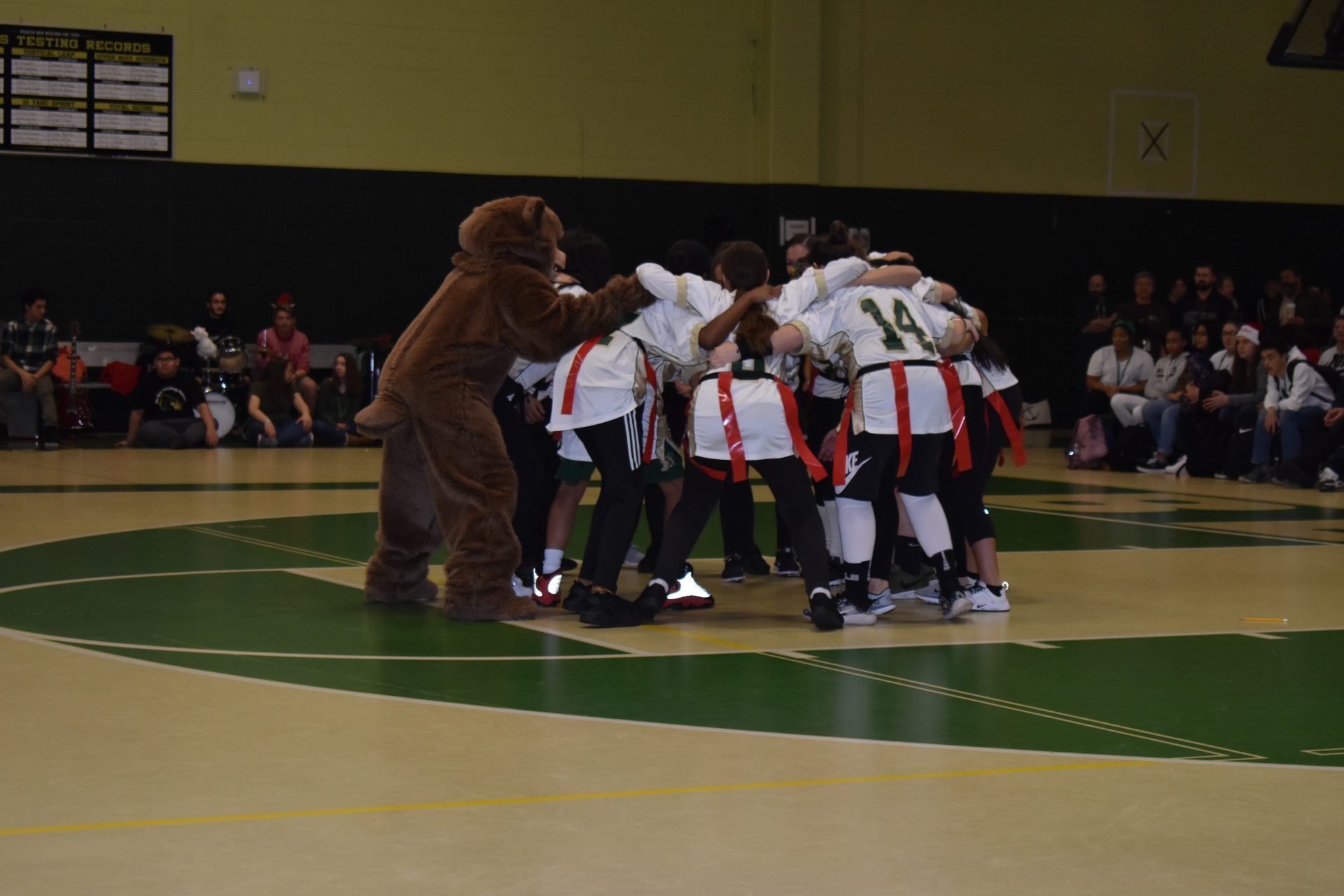 Artie the Artisan, Voc-Tech's mascot, joins in the huddle during halftime.