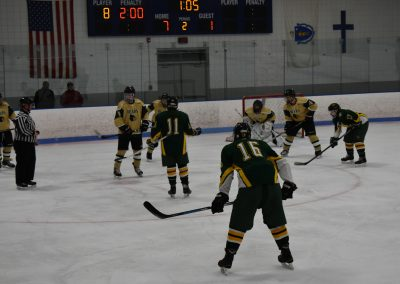 players on ice for face off
