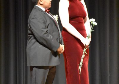 Jhona Coombs with Abbey Frias during formal Mr. Voc Tech segment