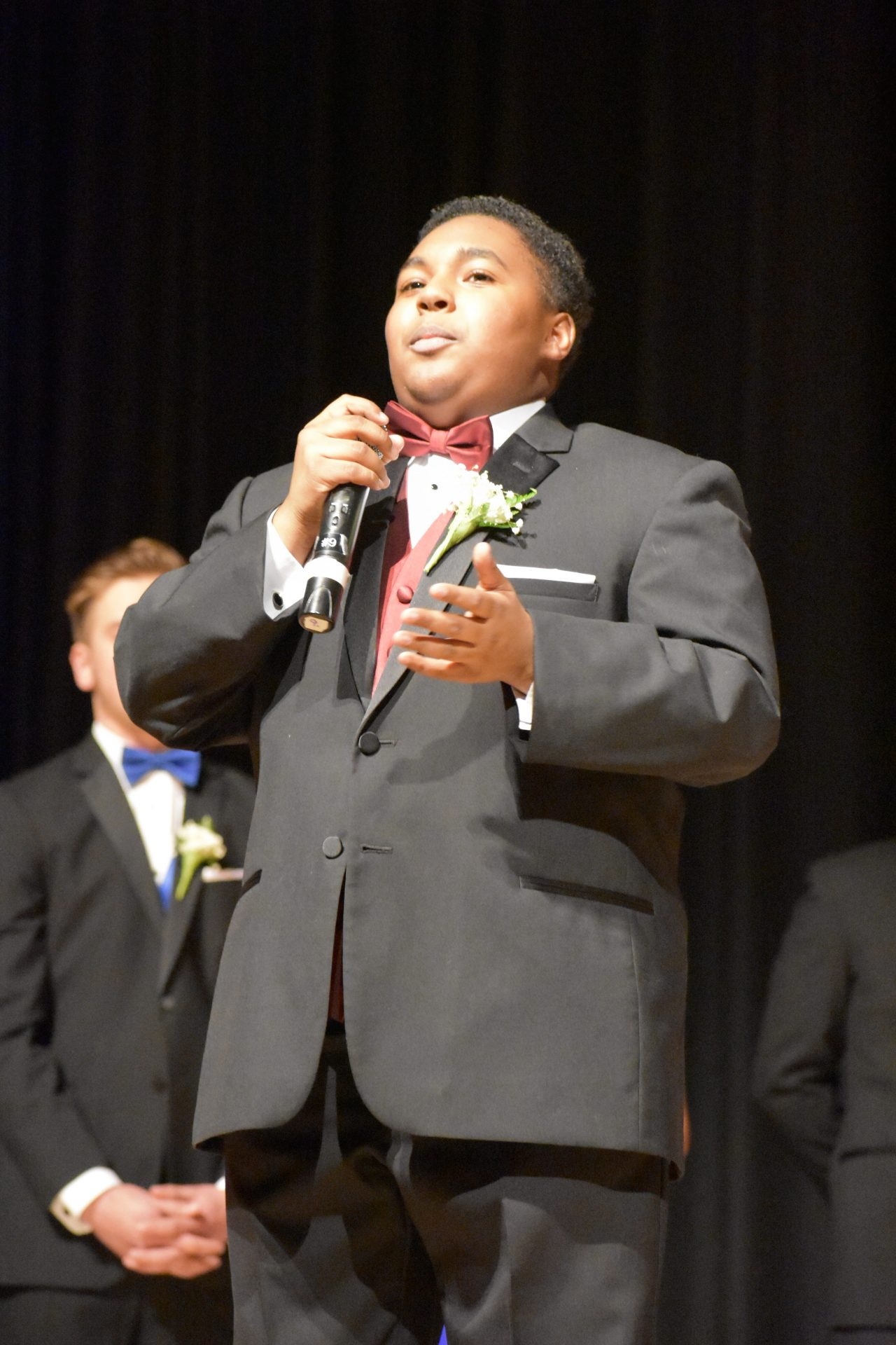 Jhona Coombs speaking during formal Mr. Voc Tech segment