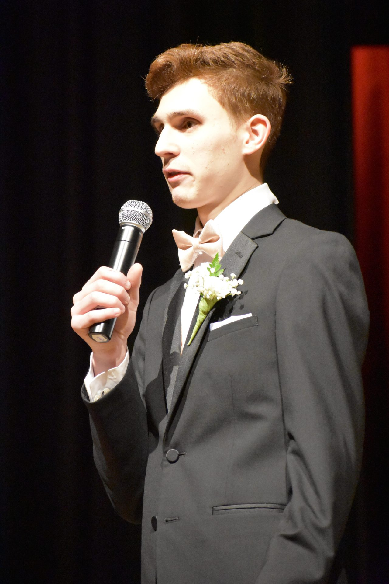 Patrick Lawrence speaking during formal Mr. Voc Tech segment