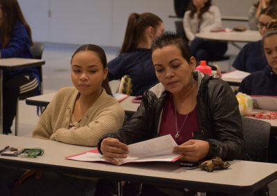 Teacher aiding student