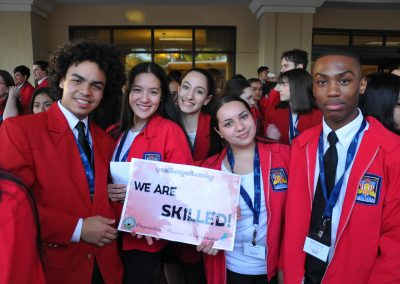 Students from Skills USA holding up a positive sign Thursday sign
