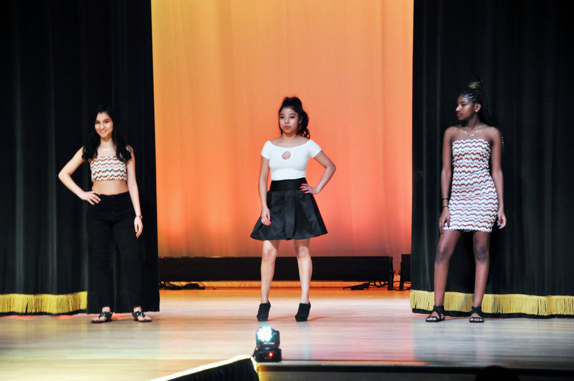 3 fashion show models posing